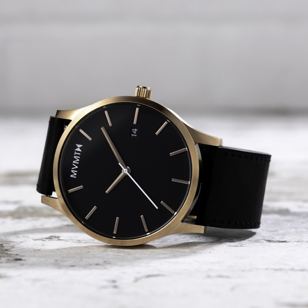 black and rose gold leather watch on a white marble background