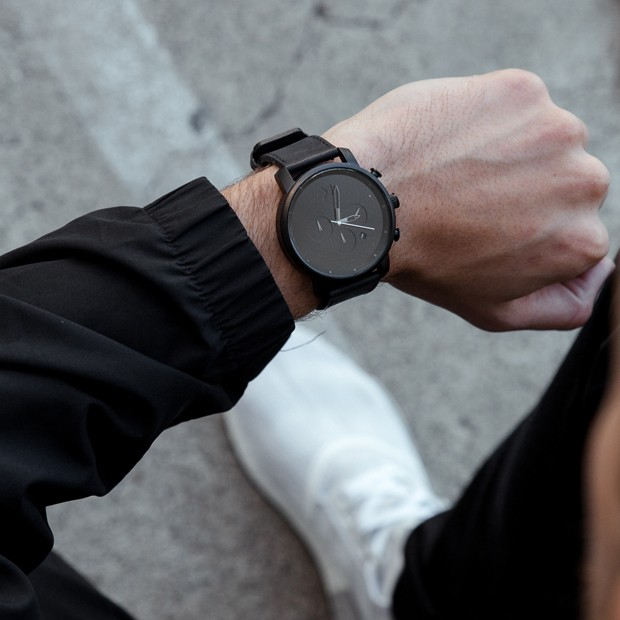 all black leather watch on a mans wrist