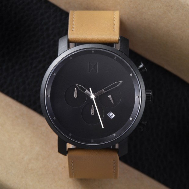 black and tan leather watch on a black and beige background