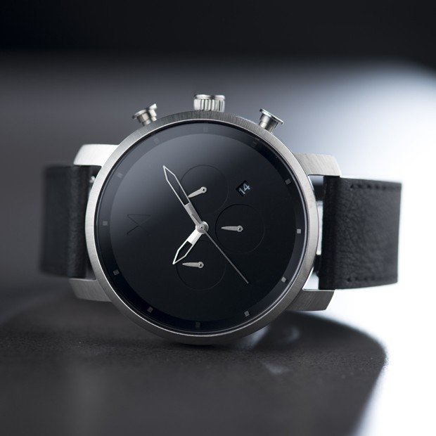 silver and black leather watch on a grey surface