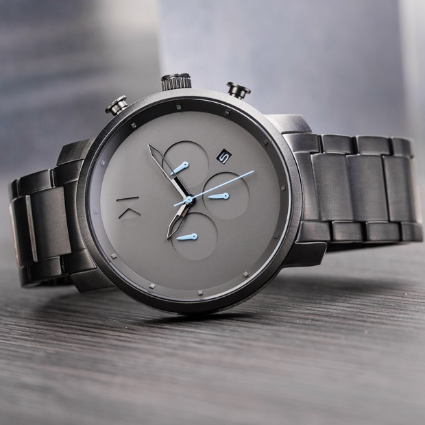gunmetal watch on a grey background