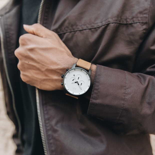 silver and brown leather watch on a mans wrist