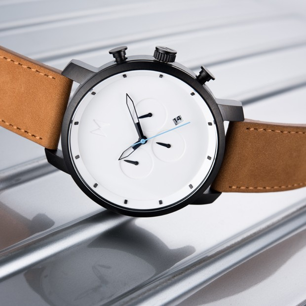silver and brown leather watch on a white surface