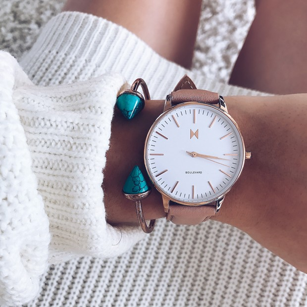 white, rose gold and pink watch on a womans wrist