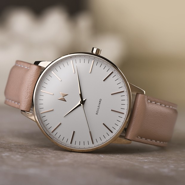white, rose gold and pink watch on a light surface