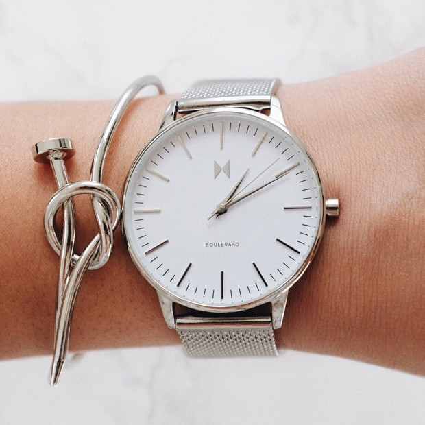 white and silver stainless steel watch on a womans wrist
