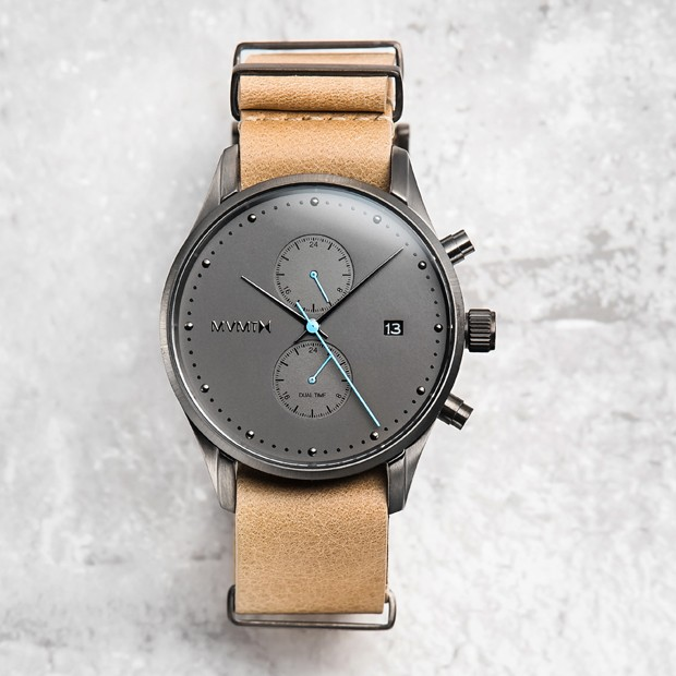 gunmetal and sandstone leather watch on a grey a background