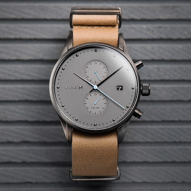 black and tan nylon watch on a grey surface