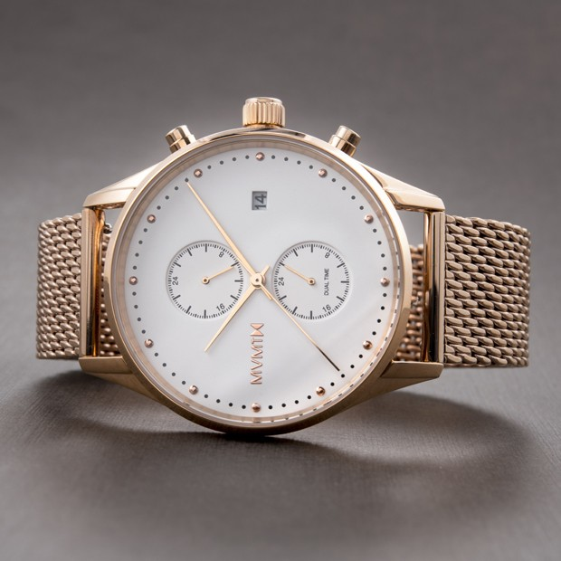 white and rose gold stainless steel watch on a grey surface