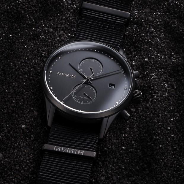 black nylon watch on a black background