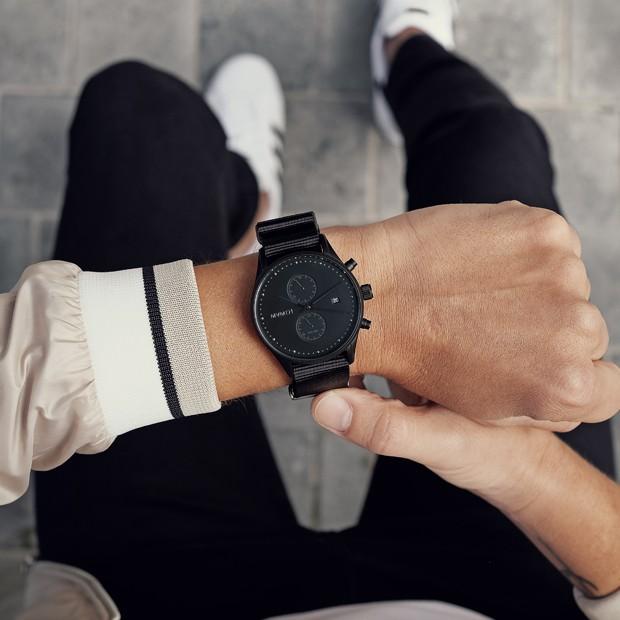 black nylon watch on a mans wrist