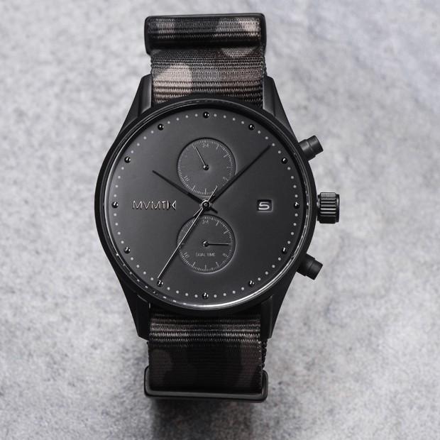 black watch with camo nylon strap on a grey background