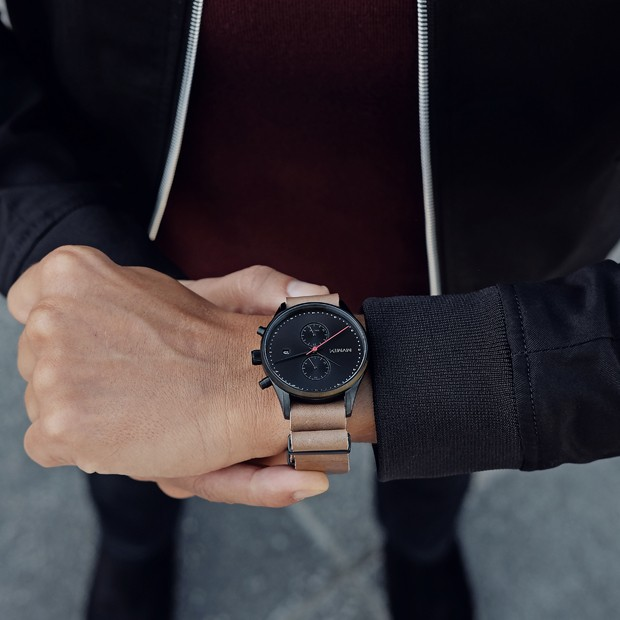 black and tan leather watch on a mans wrist