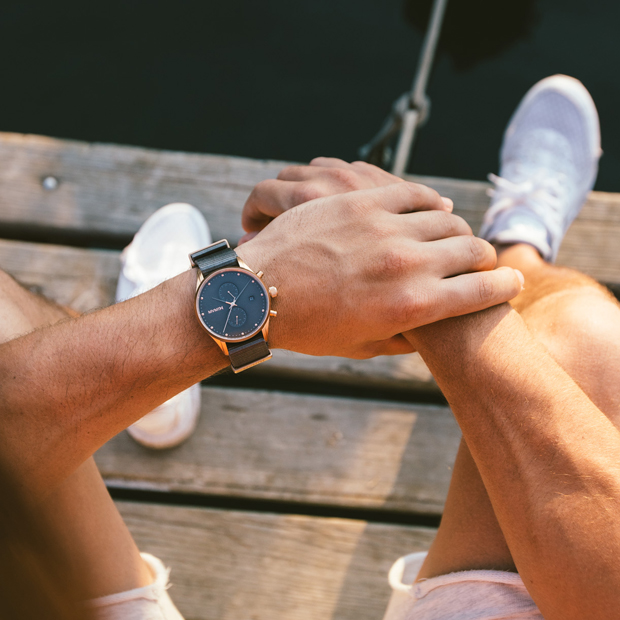 rose gold and grey nylon watch on a mans wrist