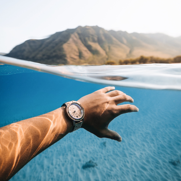 men's rogue watch hand in ocean water