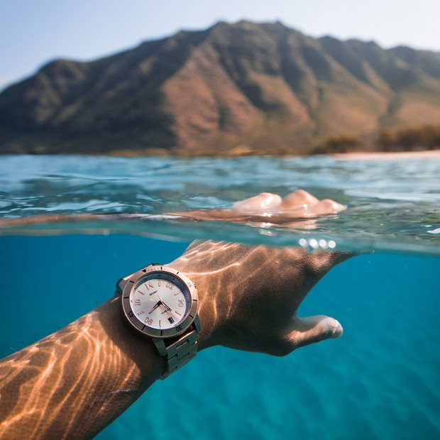 rogue watch hand in ocean water