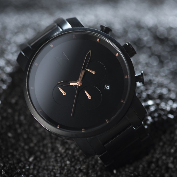 black link watch with rose gold features on a black surface