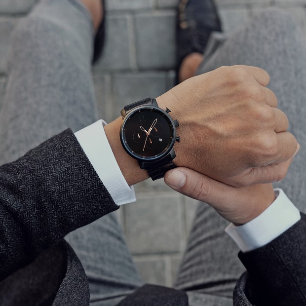 black link watch with rose gold features on a mans wrist