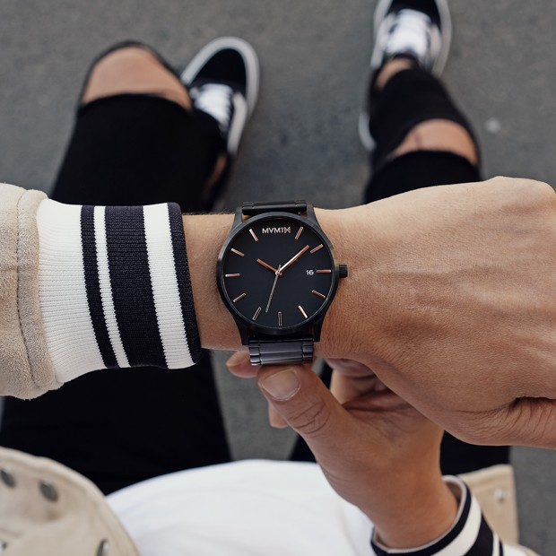 black watch with rose gold features on a mans wrist