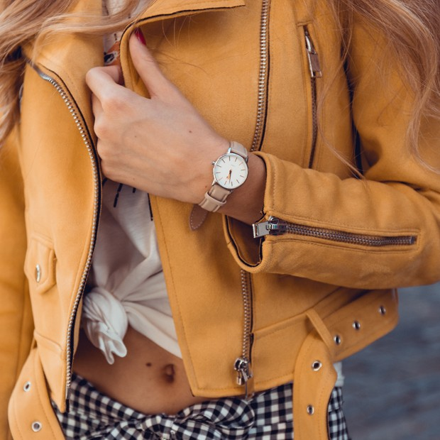 white silver and nude leather watch on a womans wrist