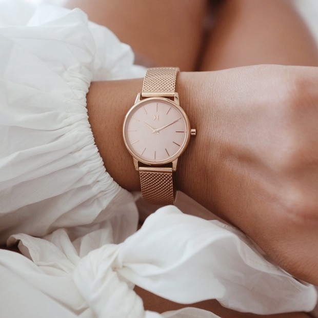 all rose gold stainless steel watch on a womans wrist