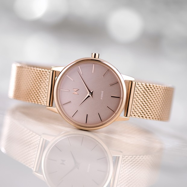 all rose gold stainless steel watch on a white surface