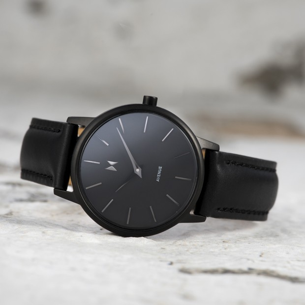 all black leather watch on a white surface