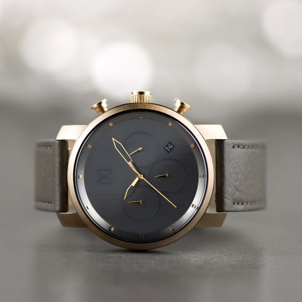 bronze and grey leather watch on a grey background