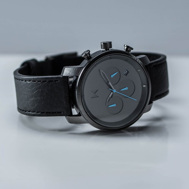 gunmetal and black leather watch on a white background