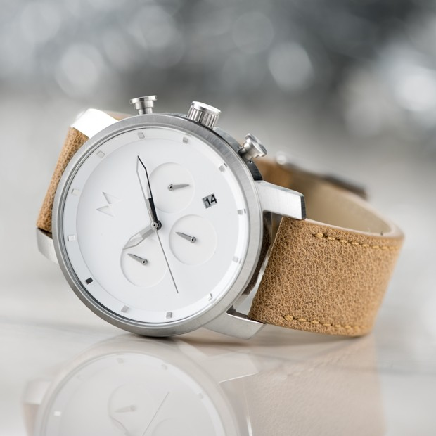 white and caramel leather watch on a white surface