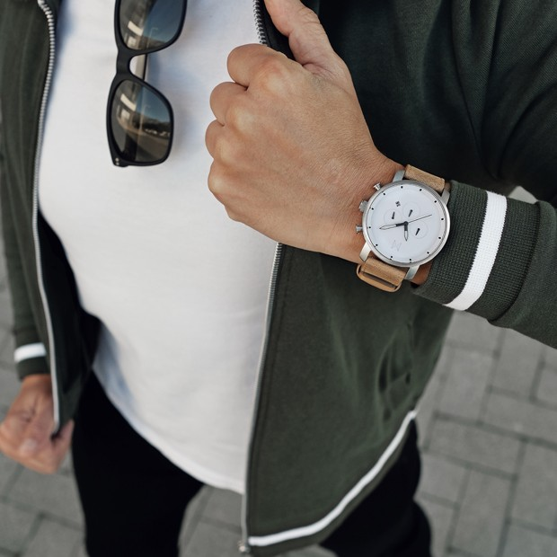 white and caramel leather watch on a mans wrist