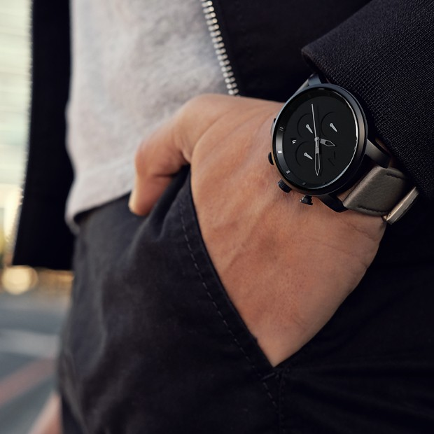 black and grey leather watch on a mans wrist