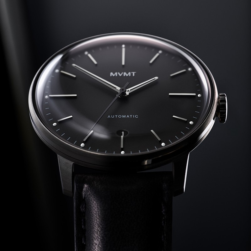 Front facing image Jet Noir automatic watch in dramatic light