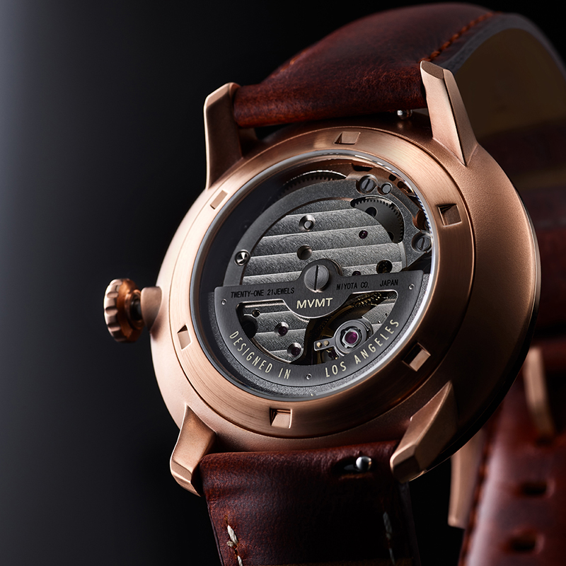 Back side of Bourbon Rose automatic watch in dramatic light