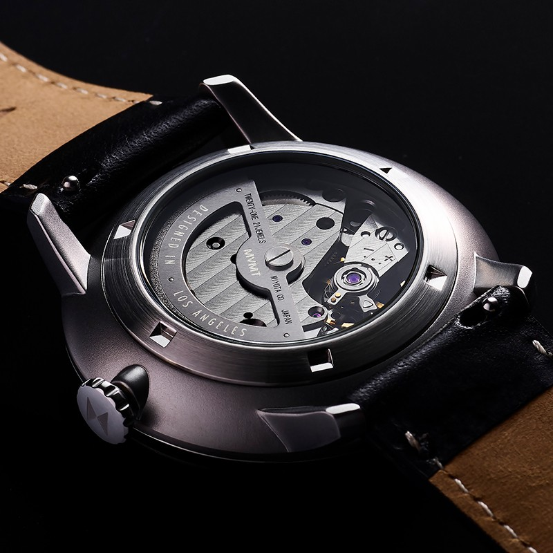 Back side of Jet Noir automatic watch in dramatic light