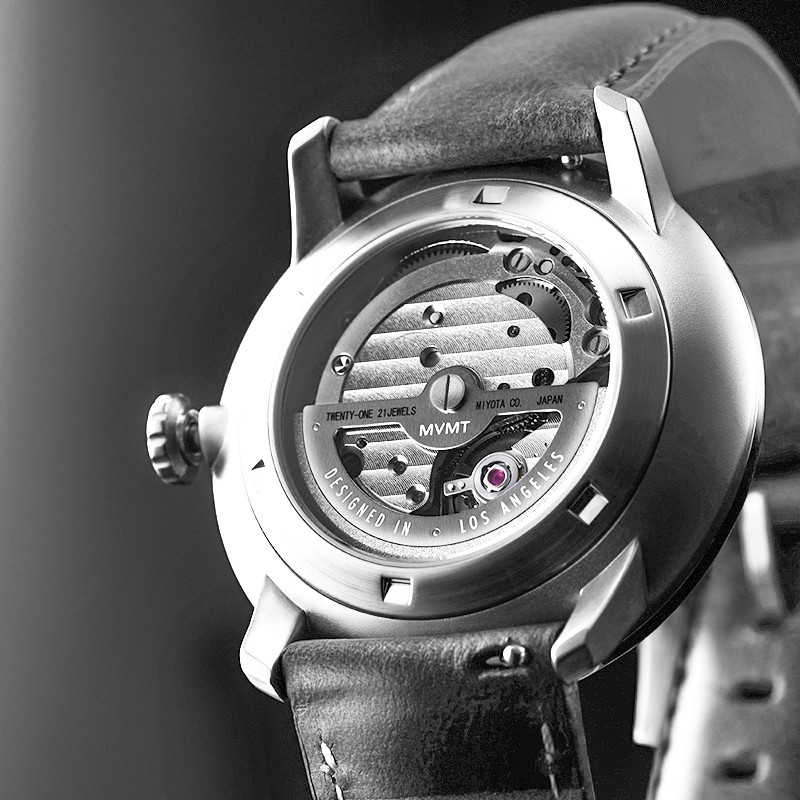 Back side of Iron Elm automatic watch in dramatic light