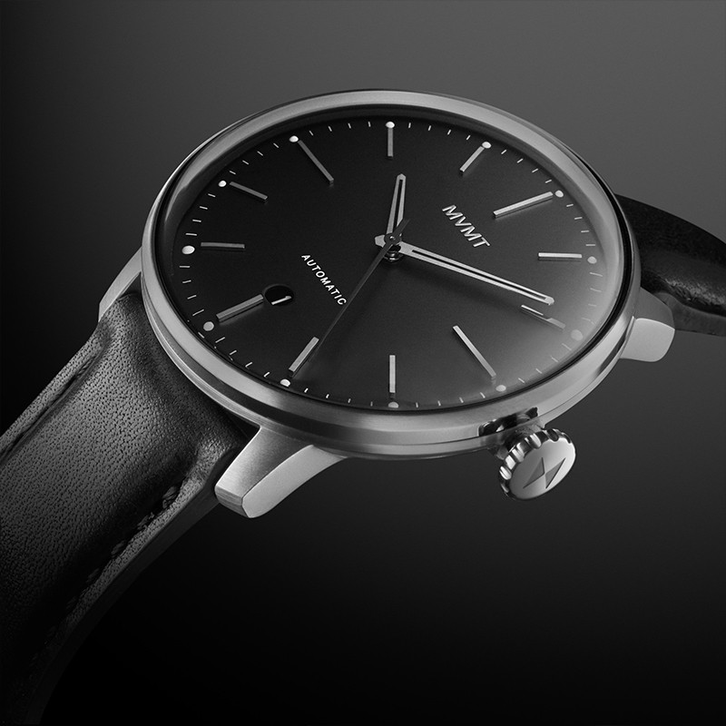 Angled view on Jet Noir automatic watch on a black background