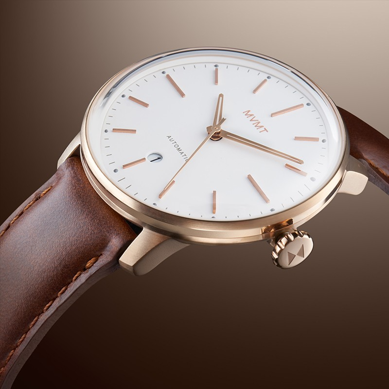 Angled view of Ivory Oak  automatic watch on a brown gradient background