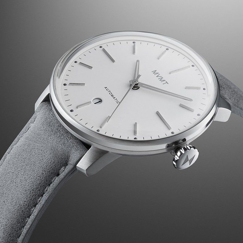 Angled view of Iron Elm automatic watch on a grey gradient backgrounf