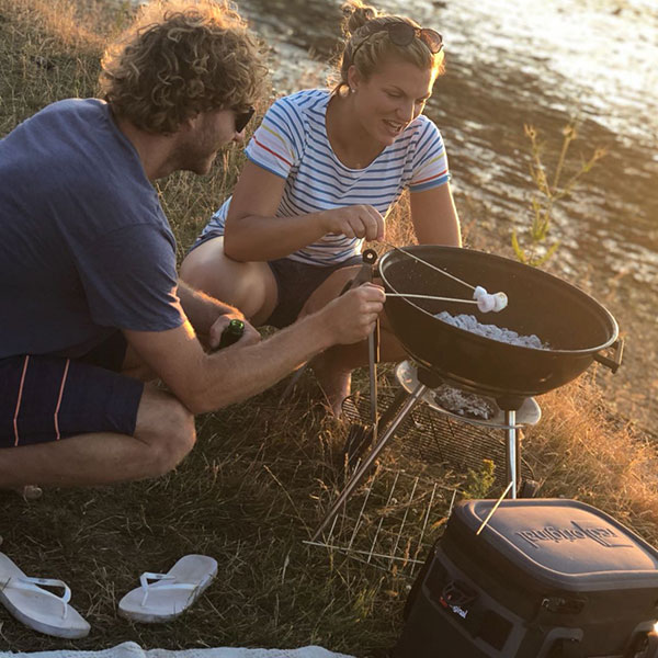 Toasting marshmallows on a BBQ