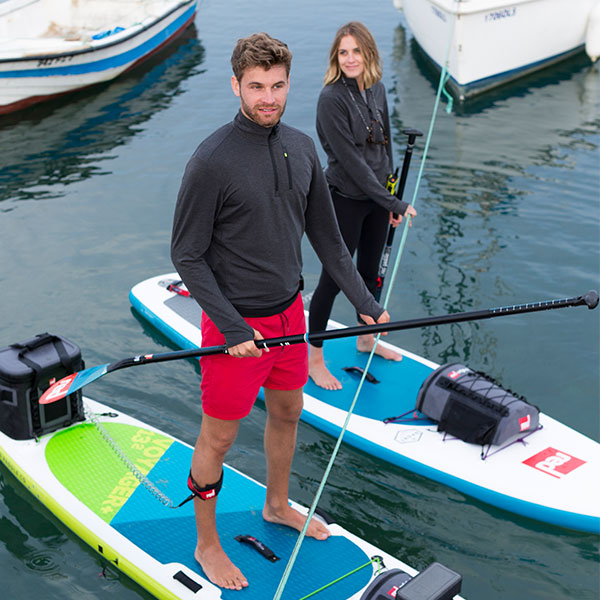 Male and Female paddle boarding.