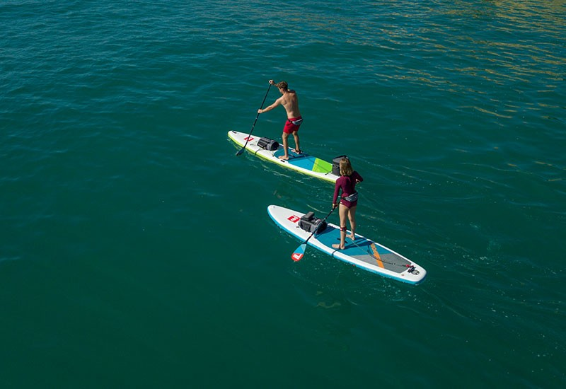 red paddle paddling boards