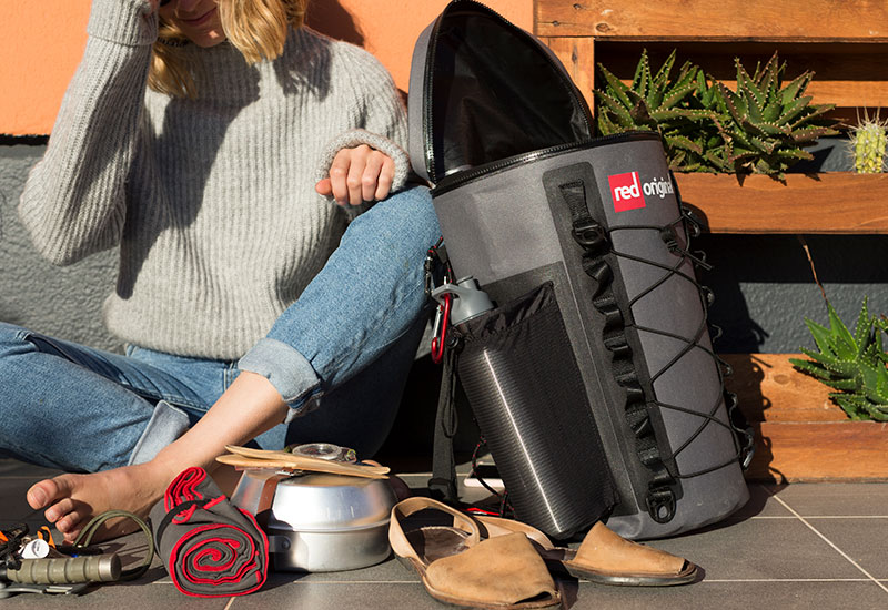 Woman packing the Red Original deck bag