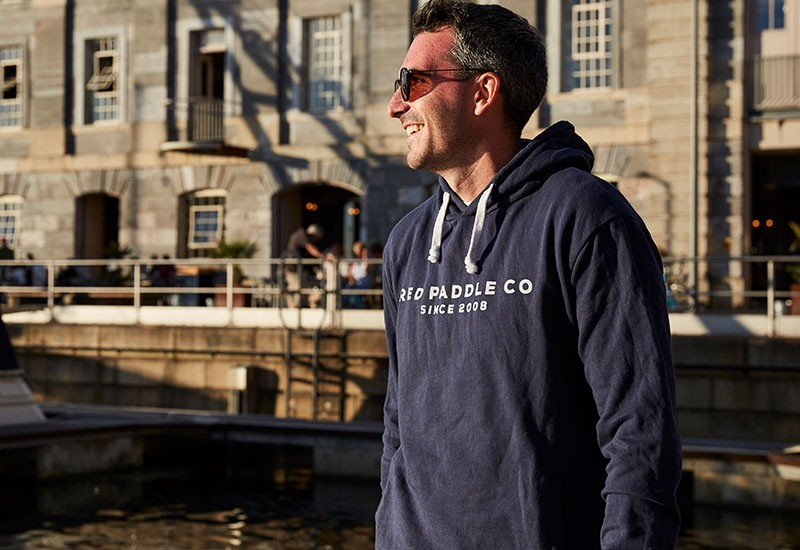man wearing blue paddle boarding hoodie