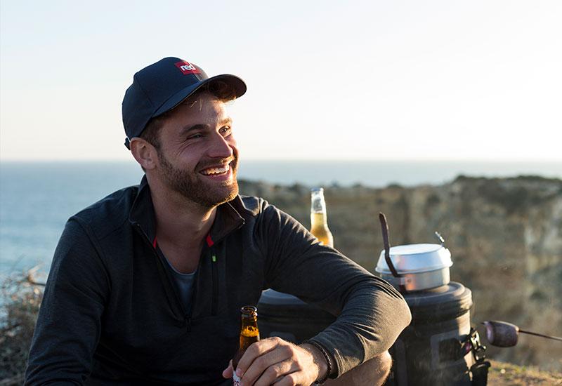 smiling man outdoors enjoying beer in the sun